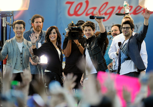 Singers Kevin Jonas, Demi Lovato, Nick Jonas and Joe Jonas wave at the crowd during a performance for ABC's 'Good Morning America' summer concert series at Rumsey Playfield on May 21, 2010 in New York City.