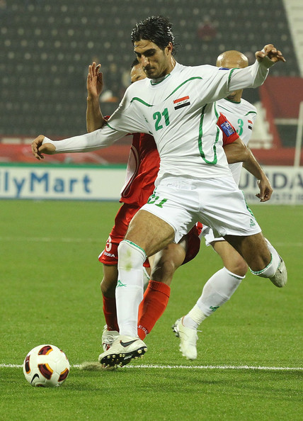 AFC Asian Cup - Iraq v DPA Korea [player,sports,soccer player,sports equipment,football player,team sport,ball game,soccer,soccer ball,football,ahmed ibrahim,jong tae se,challenges,iraq,al-rayyan,dpa korea,dpr,afc asian cup group d,afc asian cup,match]