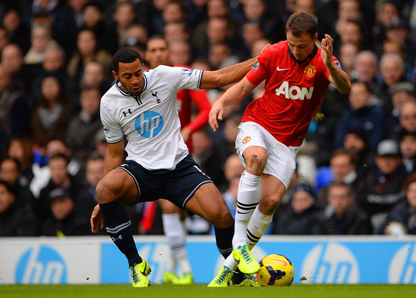 Dembele of Tottenham Hotspur and Jonny Evans of Manchester United ...