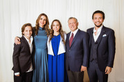 AMMAN, JORDAN- MAY 22: In this handout image provided by the Royal Hashemite Court,  Jordan's King Abdullah II (2nd-R), his wife Queen Rania and (2nd-L), Crown Prince Al Hussein (R) and Prince Hashem (L) attend the graduation ceremony of Princess Salma (C) from the International Academy on May 22, 2018 at Amman, Jordan.