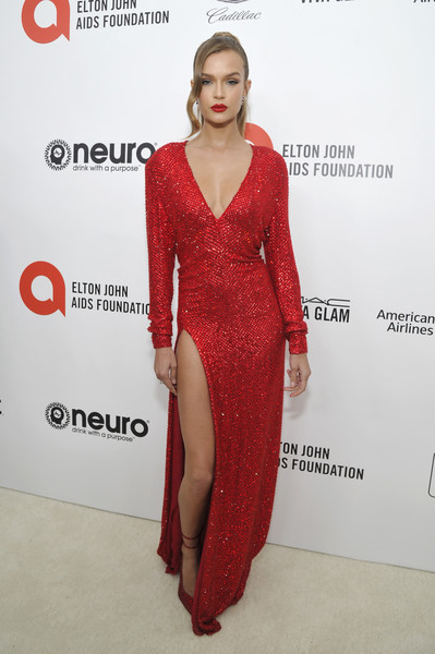 Neuro Brands Presenting Sponsor At The Elton John AIDS Foundation's Academy Awards Viewing Party [clothing,dress,fashion model,red,red carpet,carpet,fashion,shoulder,hairstyle,cocktail dress,josephine skriver,west hollywood,california,sponsor,neuro brands,elton john aids foundation,academy awards viewing party,heidi klum,elton john aids foundation,celebrity,academy awards,model,oscar party,red carpet,photograph,party]