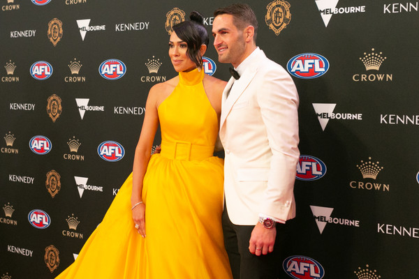 2019 Brownlow Medal [yellow,red carpet,carpet,premiere,flooring,fashion,event,award,dress,style,josh kennedy,ana calle,brownlow medal,australia,melbourne,crown palladium,swans]
