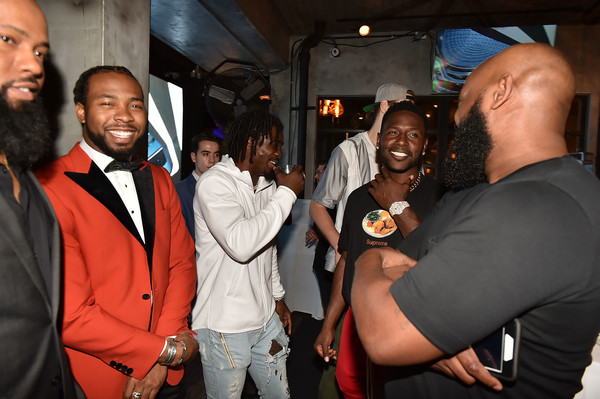 Haute Living and One Thousand Museum Celebrate Cover Star Josh Norman [event,fun,party,smile,suit,josh norman,haute living and one thousand museum celebrate cover star,antonio brown,tony brown,rudy poindexter,haute living,river,miami,florida,one thousand museum]
