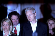 WikiLeaks founder Julian Assange (3rd L) speaks to reporters, beside lawyer Mark Stephens (2nd L)as he leaves The High Court on December 16, 2010 in London, England. Julian Assange has been released after being granted bail by the High Court.