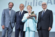 Julie Andrews is awarded the Golden Lion for Lifetime Achievement from (L-R) Luca Guadagnino, Venice Film Festival director Alberto Barbera and the President of the Venice Biennale Paolo Baratta  during the 76th Venice Film Festival at Sala Grande on September 02, 2019 in Venice, Italy.