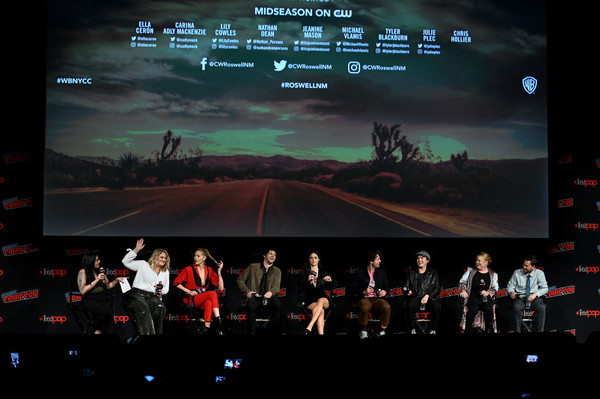 New York Comic Con 2019 - Day 4 [stage,performance,event,concert,performing arts,musical theatre,theatre,display device,music venue,technology,l-r,new york comic con,carina adly mackenzie,lily cowles,ella cer\u00e33n,tyler blackburn,julie plec,chris hollier,jeanine mason,michael vlamis]
