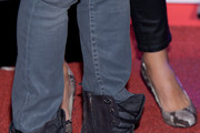 (L-R) Julio Iglesias Jr and Charisse Verhaert (shoe detail) attend Julio Jose Iglesias' birthday party at Le Boutique Club on March 14, 2013 in Madrid, Spain.