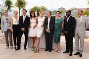 (L-R) Jury Members Olivier Assayas, Linn Ullmann, Jude Law, Martina Gusman, Uma Thurman, Robert De Niro,  Nansun Shi, Mahamat-Saleh Haroun and Johnnie To attend the Jury Photocall at the Palais des Festivals during the 64th Cannes Film Festival on May 11, 2011 in Cannes, France.