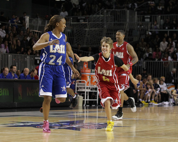 Bieber Justin Bieber (R) plays at the 2011 BBVA NBA All-Star Celebrity ...