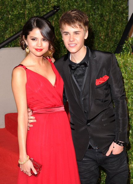 Justin Bieber Singer/actress Selena Gomez and singerJustin Bieber arrive at the Vanity Fair Oscar party hosted by Graydon Carter held at Sunset Tower on February 27, 2011 in West Hollywood, California.