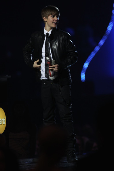 Justin Bieber (UK TABLOID NEWSPAPERS OUT) Justin Bieber accepts the International Breakthrough Act award on stage at the The BRIT Awards 2011 at O2 Arena on February 15, 2011 in London, England.