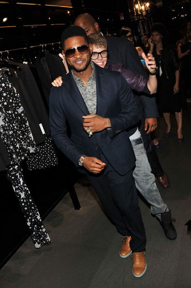 Justin Bieber Usher and Justin Bieber attend the Dolce & Gabbana celebration during Fashion's Night Out at Dolce & Gabbana Boutique on September 8, 2011 in New York City.