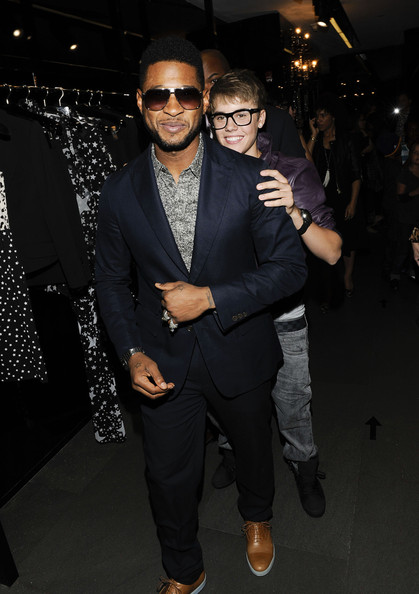 Justin Bieber Usher and Justin Bieber attend the Dolce & Gabbana Boutique on September 8, 2011 in New York City.