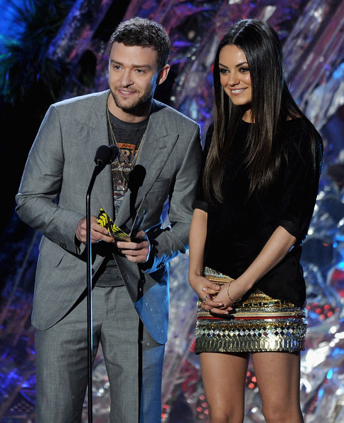 Justin Timberlake Actors Justin Timberlake (L) and Mila Kunis present an award onstage during the 2011 MTV Movie Awards at Universal Studios' Gibson Amphitheatre on June 5, 2011 in Universal City, California.