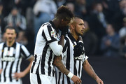 Arturo Vidal (R) of Juventus FC is comforted by team-mate Paul Pogba as he is replaced during the Serie A match between Juventus FC and AC Chievo Verona at Juventus Arena on January 25, 2015 in Turin, Italy.
