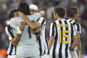 Andrea Pirlo (L), Gianluigi Buffon (C) and Giorgio Chiellini (R) of Juventus FC celebrates a victory at the end the Serie A match between Juventus FC and AC Milan on October 2, 2011 in Turin, Italy.