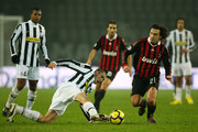 Andrea Pirlo (R) of Milan leaves Giorgio Chiellini of Juventus on the ground during the Juventus v AC Milan Serie A match at the Stadio Olimpico di Torino on January 10, 2010 in Turin, Italy.