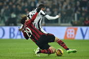 Carlos Tevez (R) of Juventus FC scores the opening goal during the Serie A match between Juventus FC and AC Milan at Juventus Arena on February 7, 2015 in Turin, Italy.