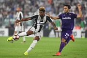 Mario Lemina (L) of Juventus FC is challenged by Giuseppe Rossi of ACF Fiorentina during the Serie A match between Juventus FC and ACF Fiorentina at Juventus Arena on August 20, 2016 in Turin, Italy.