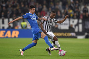 Patrice Evra (R) of Juventus FC is challenged by Alessandro Pi of Empoli FC during the Serie A match between Juventus FC and Empoli FC at Juventus Arena on April 2, 2016 in Turin, Italy.