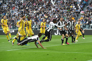 Patrice Evra (C) of Juventus FC scores the opening goal during the Serie A match between Juventus FC and UC Sampdoria at Juventus Arena on May 14, 2016 in Turin, Italy.