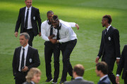 Paul Pogba and Patrice Evra of Juventus share a light moment while inspecting the pitch at Estadio Santiago Bernabeu ahead of their UEFA Champions League Semi final, Second Leg match against Real Madrid on May 12, 2015 in Madrid, Spain.