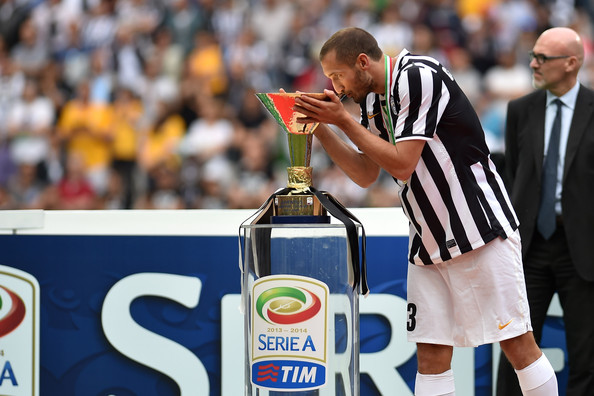 Giorgio Chiellini of Juventus FC kisses Serie A trophy at the end of the Serie A match between Juventus and Cagliari Calcio at Juventus Arena on May 18, 2014 in Turin, Italy.