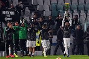 Giorgio Chiellini of Juventus shows the Italian Supercup trophy won on 16th Jennuary before the Serie A match between Juventus and Chievo at Allianz Stadium on January 21, 2019 in Turin, Italy.