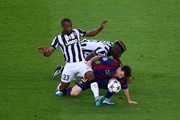 Lionel Messi of Barcelona is tackled by Patrice Evra and Paul Pogba of Juventus during the UEFA Champions League Final between Juventus and FC Barcelona at Olympiastadion on June 6, 2015 in Berlin, Germany.