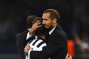 Andrea Pirlo (L) of Juventus is consoled by Giorgio Chiellini of Juventus after the UEFA Champions League Final between Juventus and FC Barcelona at Olympiastadion on June 6, 2015 in Berlin, Germany.