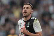 Aaron Ramsey of Juventus celebrates after scoring the equalizing goal during the Serie A match between Juventus and Hellas Verona at Allianz Stadium on September 21, 2019 in Turin, Italy.