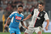 Lorenzo Insigne (L) of SSC Napoli is challenged by Mattia De Sciglio of Juventus during the Serie A match between Juventus and SSC Napoli at Allianz Stadium on August 31, 2019 in Turin, Italy.