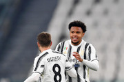 Weston McKennie of Juventus celebrates with team mate Aaron Ramsey after scoring his team's first goal during the Serie A match between Juventus and Torino FC at Allianz Stadium on December 05, 2020 in Turin, Italy. Football Stadiums around Italy remain empty due to the Coronavirus Pandemic as Government social distancing laws prohibit fans inside venues resulting in fixtures being played behind closed doors.