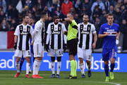Cristiano Ronaldo of Juventus speaks with the referee Paolo Valeri as Fabio Quagliarella of Sampdoria celebrates after scoring a penalty (1-1) during the Serie A match between Juventus and UC Sampdoria on December 29, 2018 in Turin, Italy.