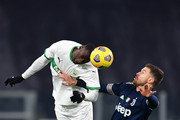 Aaron Ramsey of Juventus F.C. and Pedro Obiang of Sassuolo compete for a header during the Serie A match between Juventus and US Sassuolo at Allianz Stadium on January 10, 2021 in Turin, Italy. Sporting stadiums around Italy remain under strict restrictions due to the Coronavirus Pandemic as Government social distancing laws prohibit fans inside venues resulting in games being played behind closed doors.