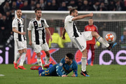 Alvaro Morata (C) of Atletico Madrid protest as Giorgio Chiellini (R) of Juventus kicks the ball during the UEFA Champions League Round of 16 Second Leg match between Juventus and Club de Atletico Madrid at Allianz Stadium on March 12, 2019 in Turin, .