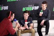 (L-R) Radio personality Jesse Lozano, recording artist Shawn Mendes, and radio personality JoJo Wright attend KIIS FM's Jingle Ball 2014  powered by LINE at Staples Center on December 5, 2014 in Los Angeles, California.