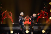 Recording artists Pharrell Williams (center L) and Gwen Stefani (center R) perform onstage during KIIS FM's Jingle Ball 2014  powered by LINE at Staples Center on December 5, 2014 in Los Angeles, California.
