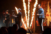 Joe Trohman, Patrick Stump and Pete Wentz of Fall Out Boy perform onstage during KISS 108's Jingle Ball 2017 presented by Capital One at TD Garden on December 10, 2017 in Boston, Mass.