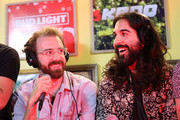 (L-R) Payam Doostzadeh and Jacob Tilley of Young the Giant speak during an interview at KROQ Absolut Almost Acoustic Christmas at The Forum on December 9, 2018 in Inglewood, California.