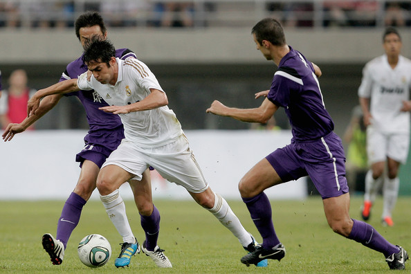 Tianjin Teda v Real Madrid - Real Madrid's China Tour [player,sports,tournament,sports equipment,team sport,ball game,football player,soccer player,sport venue,football,kaka,ball,c,water drop stadium,tianjin,china,real madrid,tianjin teda,china tour,match]