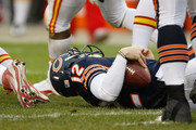 Caleb Hanie #12 of the Chicago Bears lays on the field after being sacked during the game against the Kansas City Chiefs at Soldier Field on December 4, 2011 in Chicago, Illinois. The Chiefs defeated the Bears 10-3.
