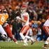 Alex Smith Photos - Alex Smith #11 of the Kansas City Chiefs in action against the Denver Broncos at Sports Authority Field at Mile High on November 27, 2016 in Denver, Colorado. - Kansas City Chiefs v Denver Broncos