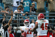 Tight end Leonard Pope #45 of the Kansas City Chiefs celebrates a touchdown catch by wide receiver Chris Chambers #11 as side judge Greg Bradley #98 confirms the score against the Jacksonville Jaguars at Jacksonville Municipal Stadium on November 8, 2009 in Jacksonville, Florida. The Jaguars defeated the Chiefs 24-21.