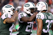Buster Skrine #41, Morris Claiborne #21 and Jamal Adams #33 of the New York Jets celebrate after holding the Kansas City Chiefs on fourth down late in the fourth quarter during their game at MetLife Stadium on December 3, 2017 in East Rutherford, New Jersey.
