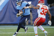 Quarterback Ryan Tannehill #17 of the Tennessee Titans rushes against Tyrann Mathieu #32 of the Kansas City Chiefs during the second half at Nissan Stadium on November 10, 2019 in Nashville, Tennessee.