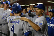 Alex Gordon #4 of the Kansas City Royals is congratulated by Raul Ibanez #18 in the dugout after scoring a run against the Arizona Diamondbacks during the fifth inning of the MLB game at Chase Field on August 5, 2014 in Phoenix, Arizona.