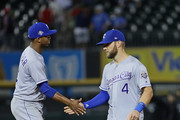 Alcides Escobar #2 (L) and Alex Gordon #4 of the Kansas City Royals.celebrate a win over the Chicago White Sox at Guaranteed Rate Field on August 1, 2018 in Chicago, Illinois. The Royals defeated the White Sox 10-5.