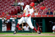 Joey Votto #19 of the Cincinnati Reds hits a single in the first inning against the Kansas City Royals at Great American Ball Park on September 25, 2018 in Cincinnati, Ohio.