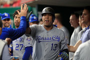 Salvador Perez #13 of the Kansas City Royals celebrates with teammates after scoring in the second inning against the Cincinnati Reds at Great American Ball Park on September 25, 2018 in Cincinnati, Ohio.